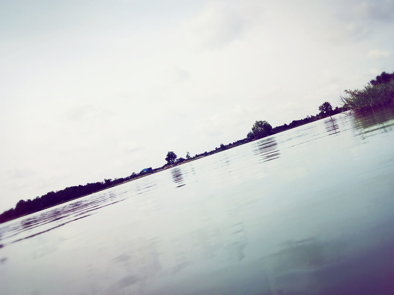 sky, water, cloud - sky, reflection, day, outdoors, nature, low angle view, large group of people, scenics, beauty in nature, tree, people