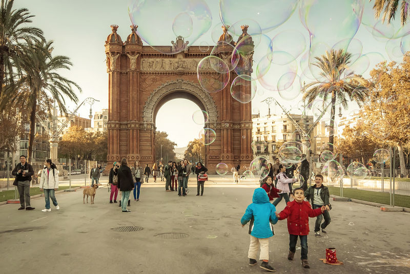 Having fun with supersized soap bubbles at the Arch of Triumph of Barcelona City, Spain Alepho Arch Of Triumph Barcelona, Spain Beautiful Day Bubbles Candy Capture The Moment City Life Enyoing Enyoing The Moment Funtimes Happiness Happy People Having Fun Kids Kids Playing Moments Outdoors People Promenade Soap Bubbles Street Photography Travel Urban Urbanphotography