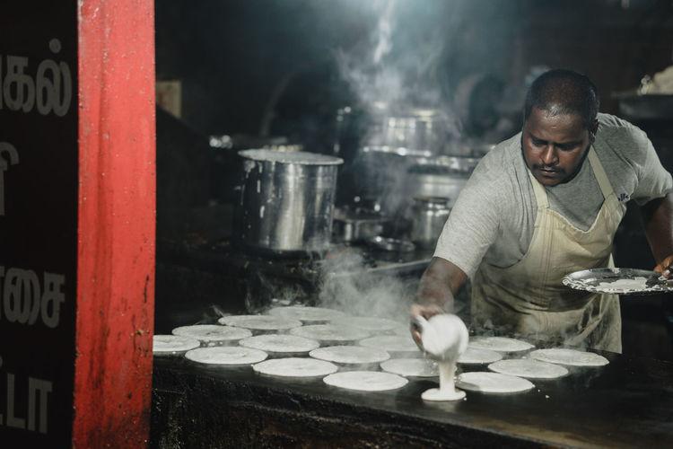 Man working in kitchen