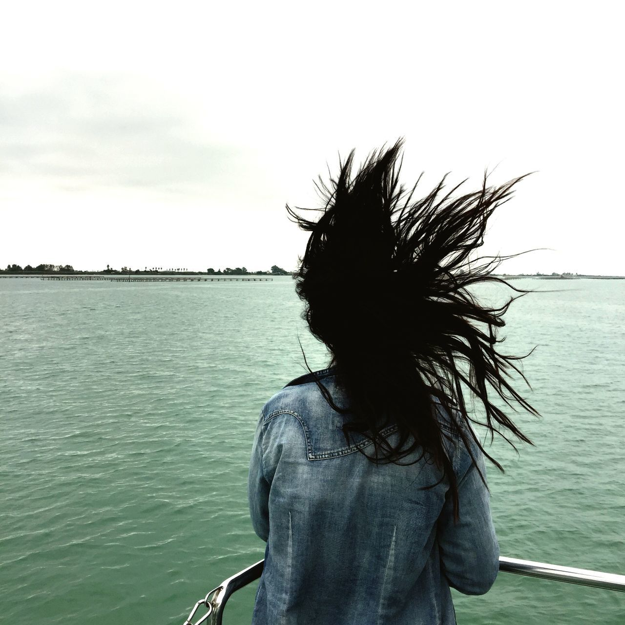 water, real people, rear view, one person, sea, leisure activity, sky, lifestyles, day, outdoors, nature, women, beauty in nature, people