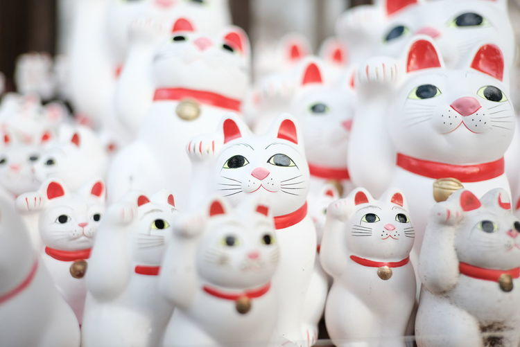Close-up of cat figurines for sale in market