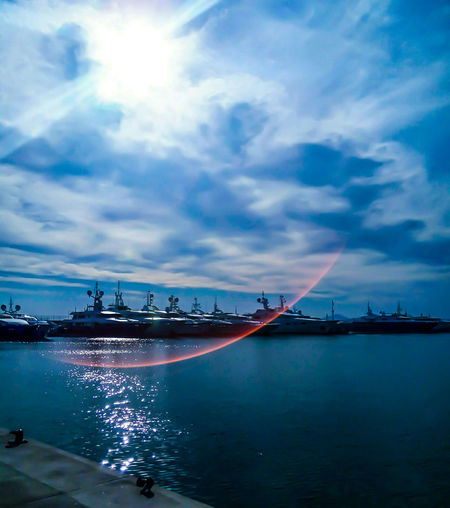 Yachts, boats sea, sun reflection in water by elvio Reflection Sky Water Travel Destinations Cloud - Sky City Harbor Sunset Artphotography Fine Arts Photography Background Photography GalleryOfModernArt Wallpaperart Springtime Beauty Of Nature Sunset And Clouds