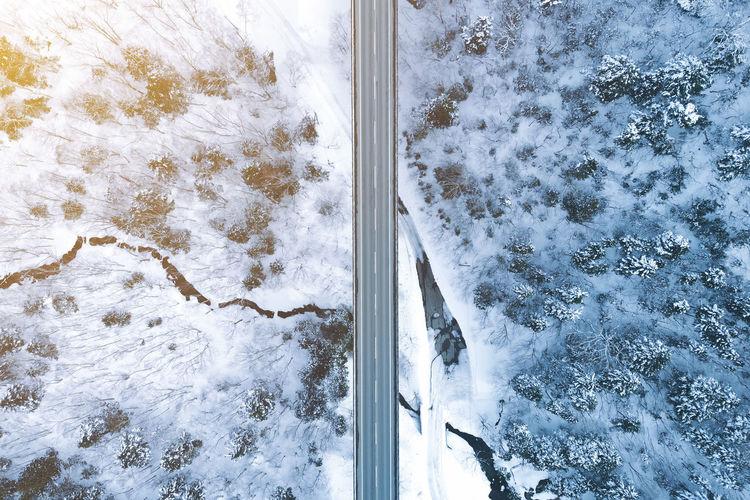 High angle view of sea seen through snow