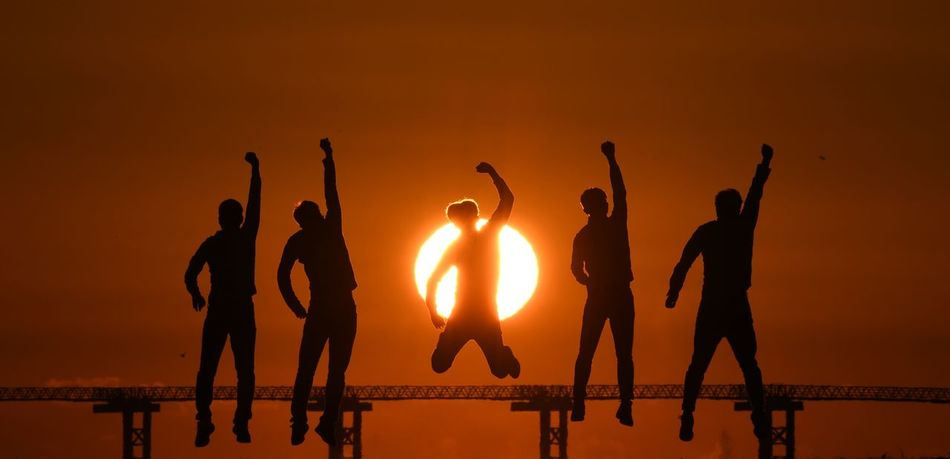 Young people are jumping towards the rising sun. Hopeful Hope - Concept Hope Sun Day Fighting Beach Boys Boys Boys Boys Young Young Men Sunrise Photography Sunrise Sunshine Sun Korea Man Sunset Silhouette Water Sea Sun Beach Men Real People Leisure Activity Outdoors Lifestyles Full Length Jumping Togetherness