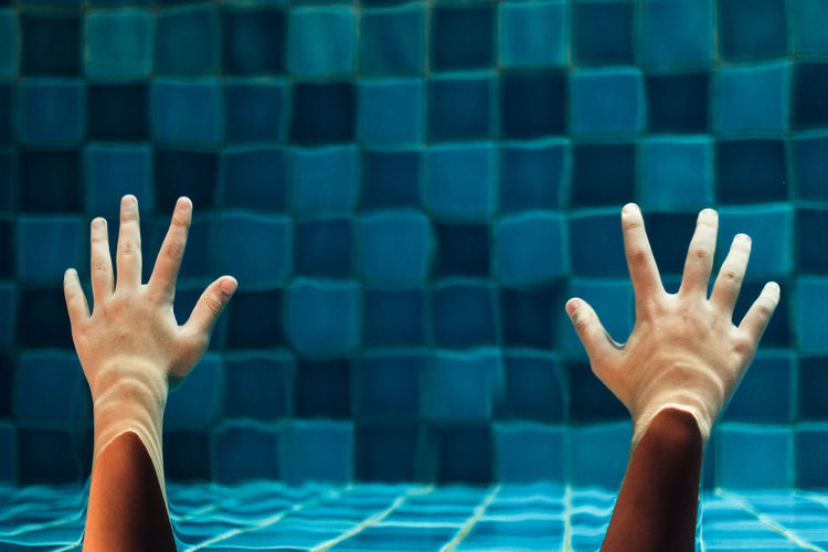 Midsection of people at swimming pool