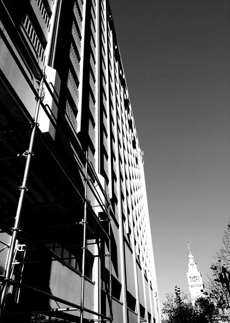 """""""Fade To Ferry Building"""" A building on Market Street in San Francisco, California catches the last rays of the setting sun as it leads the eye to the Ferry Building on the Embarcadero out in the distance. Architecture Architecture_collection Architecturelovers Blackandwhite Black And White Black & White Blackandwhite Photography Urban Urban Geometry Urbanphotography Urbanexploration Marketstreet San Francisco Ferrybuilding Sunset Light And Shadow"""