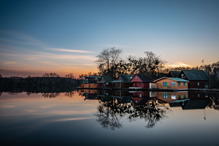 Copy Space Architecture Reflection Water Sunset Nature Sky Dusk Trees Tree Sundown Blue Outdoors Natural Tranquility Lake Silence Transportation Long Exposure Waterfront Lakeside No People Orange Color Built Structure House