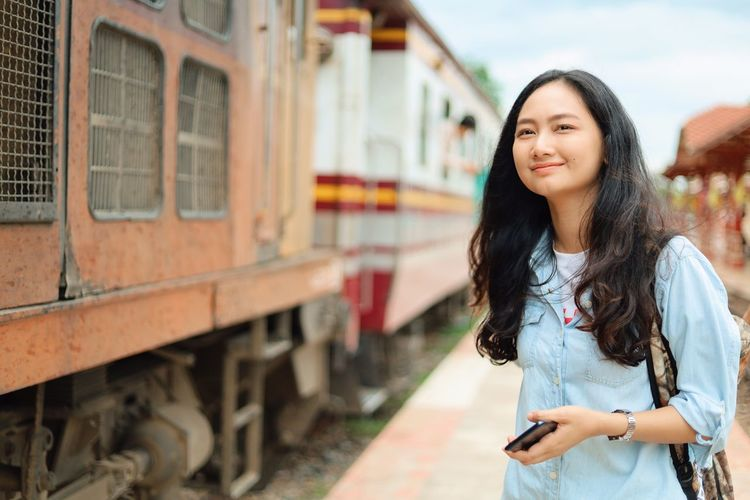 Rail Transportation Young Adult Public Transportation One Person Train Transportation Long Hair Young Women Mode Of Transportation Train - Vehicle Hair Track Railroad Track Women Standing Hairstyle Lifestyles Travel Beauty Architecture Beautiful Woman Outdoors