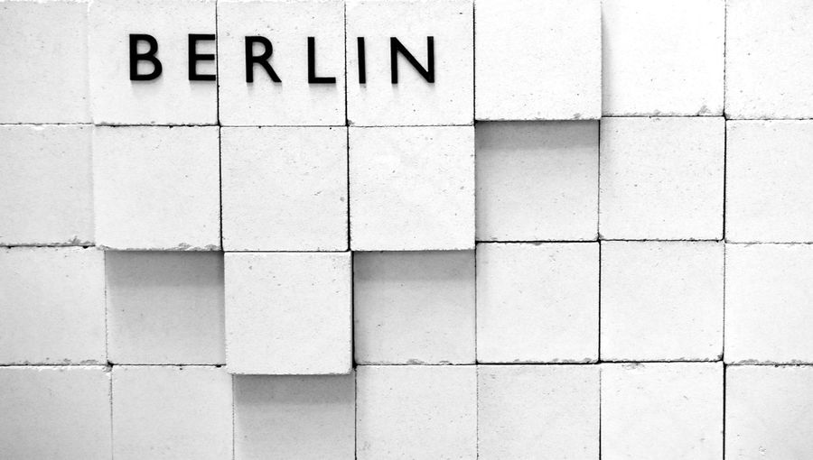 Close-up of berlin text on white blocks