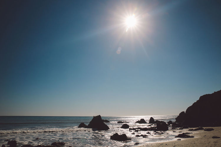 California El Matador Beach Pacific Beach Beauty In Nature Clear Sky Day Horizon Over Water Lens Flare Nature No People Ocean Outdoors Rock - Object Rock Formation Scenics Sea Sky Sun Sunlight Tranquil Scene Tranquility Water