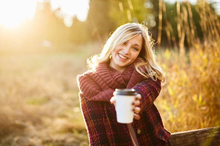 Adult Adults Only Beautiful Woman Blond Hair Coffee - Drink Coffee Cup Cup Drink Drinking Enjoyment Focus On Foreground Food And Drink Holding Leisure Activity Long Hair Mug Nature One Person One Woman Only One Young Woman Only Only Women Outdoors Portrait Smiling Sunlight