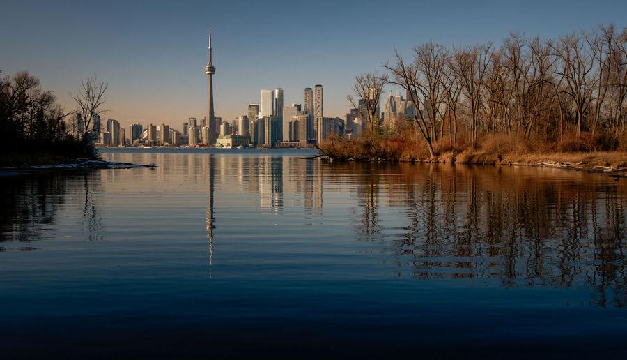 Toronto skyline and Toronto island Reflection Water Building Exterior Architecture Waterfront Lake Tree City Skyscraper No People Travel Destinations Tall - High Toronto Skyline Urban Skyline Landscape Toronto Islands Winter