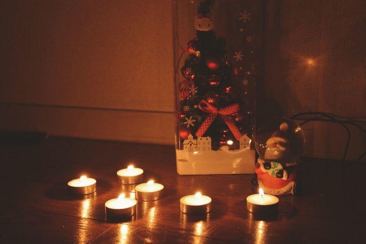 Illuminated candles at night