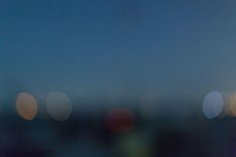 Defocused image of moon against sky at night