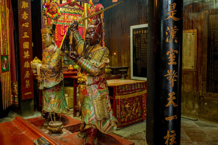 Image from Man Mo temple, Hong Kong Man Mo Man Mo Temple Statue Architecture Belief Buddist Buddist Temple Building Built Structure Chinese Creativity Day Human Representation Indoors  No People Ornate Place Of Worship Religion Representation Sculpture Spirituality Statue Statues
