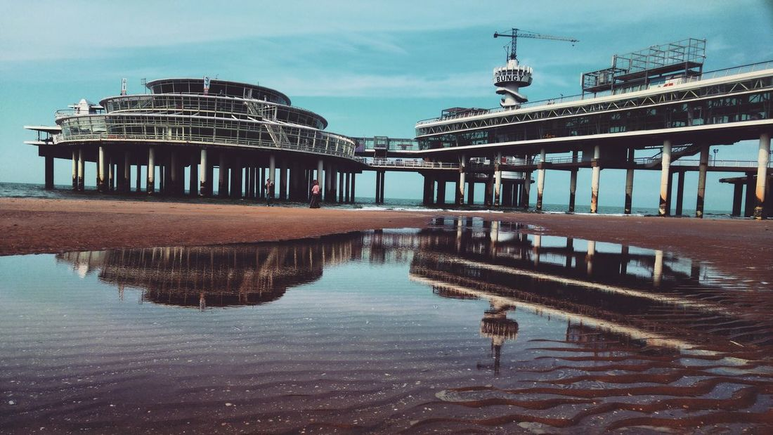 Scheveningse Pier Scheveningen  Pier Scheveningen Pier Blue Sky Beach Beachphotography Beachsand Shore Reflection Reflection_collection Reflections In The Water Reflection Photography Wanderlust