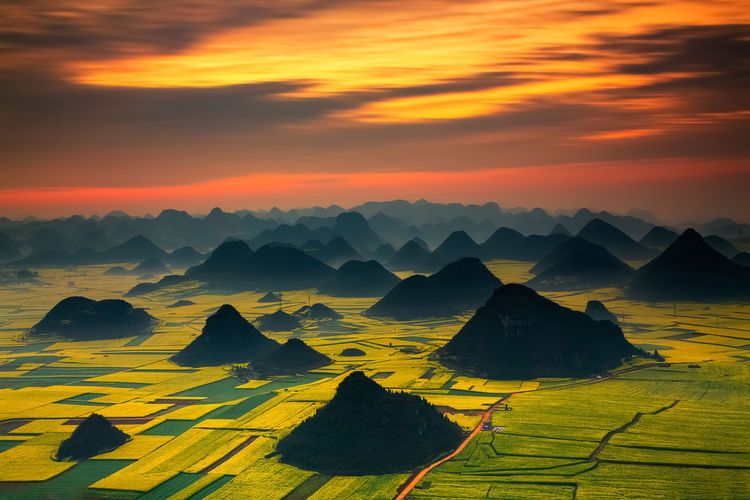 Aerial view of dramatic landscape during sunset