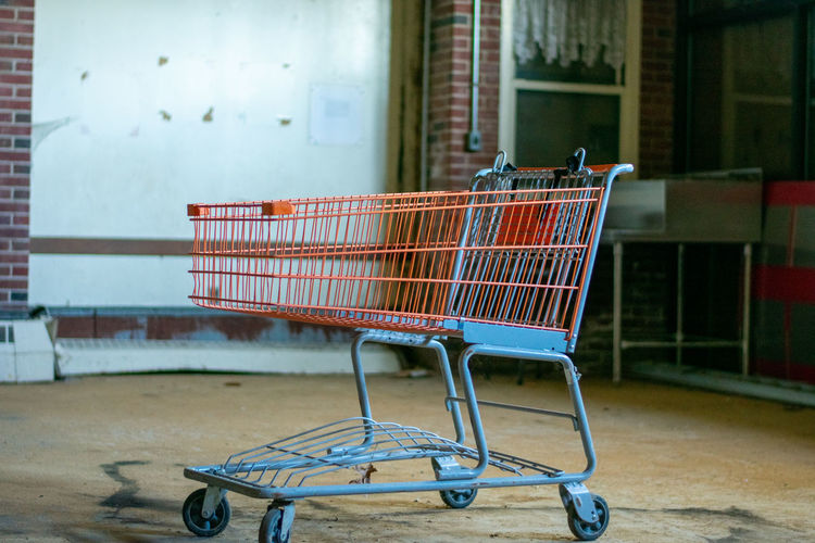 Side view of an abandoned shopping cart at store