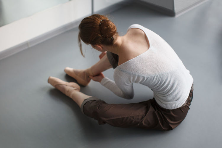 High angle view of woman dancing against wall