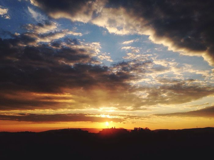Scenic shot of silhouette landscape against sunset