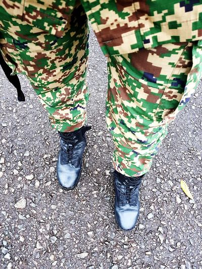 Training Soldier Soldiers Uniform Camouflage Clothing Camouflage Army Training This Is Strength Low Section Human Leg High Angle View Shoe Close-up Footwear Pair Ground Trousers