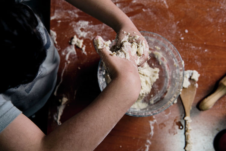 High angle view of hands preparing food