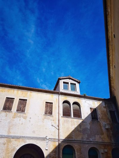 Architecture Built Structure Building Exterior Blue Window History Travel Destinations Sky Outdoors Day Vibrant Sky Archetypes Crosslines Snug Shadows
