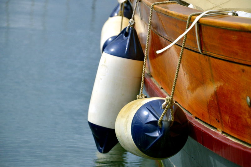 Buoys Hanging From Boat Moored In Sea