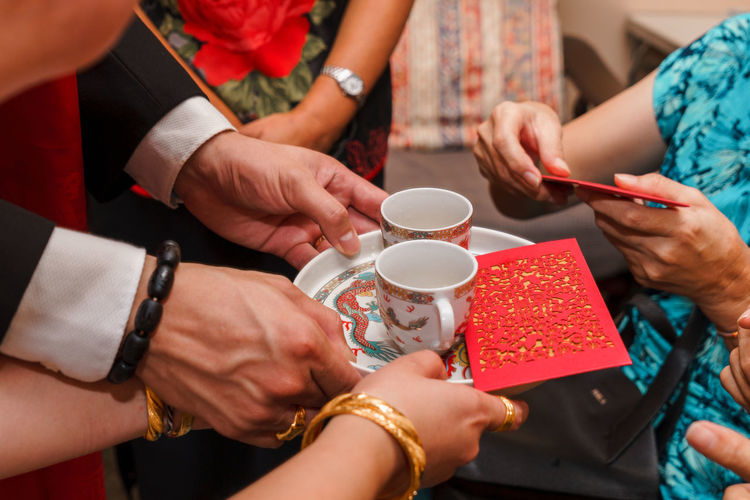 Group Of People Human Hand Drink Cup Hand Women Holding Food And Drink Real People Mug Adult Refreshment Table Celebration Coffee Cup Men Togetherness Coffee Event Lifestyles Positive Emotion Wedding Tea Ceremony Tea Serving Red Package