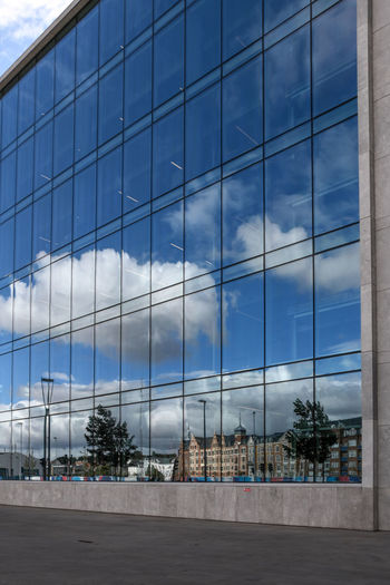 Architecture Blue Building Building Exterior Built Structure City Cloud - Sky Day Glass - Material Modern Nature No People Office Office Building Exterior Outdoors Plant Reflection Sky Tree Window