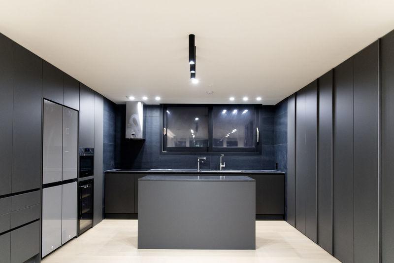 Interior of illuminated kitchen