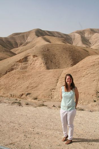 Portrait of a smiling young woman in desert