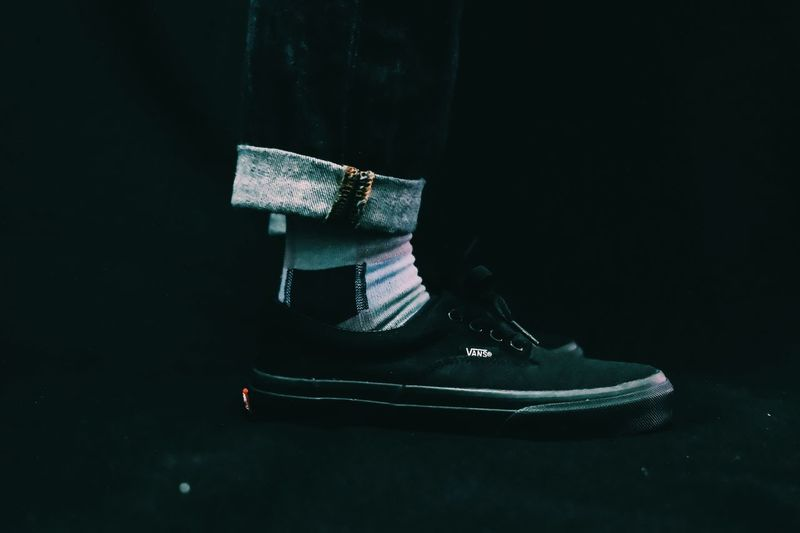 Shoe Indoors  Low Section Still Life Fashion Black Background Shoelace Real People Close-up One Person Human Leg Pair Canvas Shoe Clothing High Angle View Human Body Part Studio Shot Sport Personal Accessory Human Foot