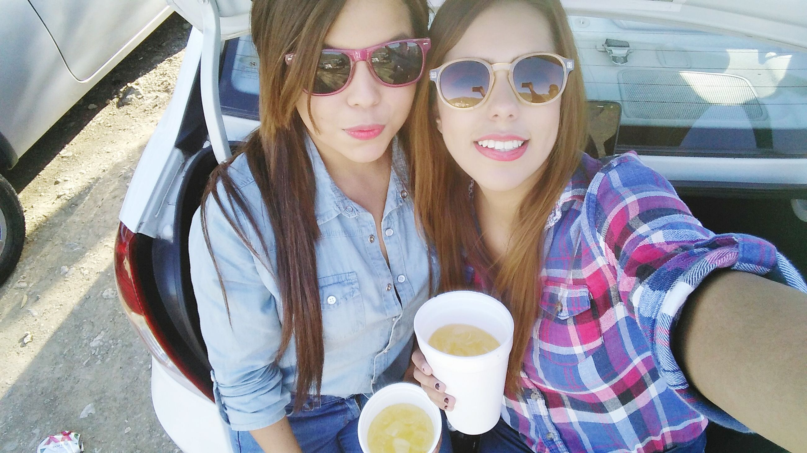 lifestyles, casual clothing, leisure activity, person, looking at camera, sunglasses, portrait, young adult, front view, drink, food and drink, sitting, smiling, standing, refreshment, young women, happiness