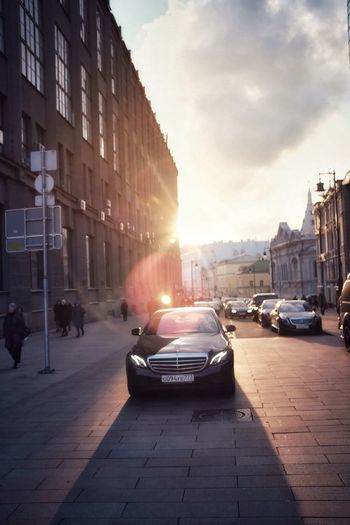Moscow Architecture Building Exterior Car Built Structure Sunset Street Sunlight City Land Vehicle Sky Transportation Outdoors Sun Day Cityscape No People Luxury Deep Sunlight