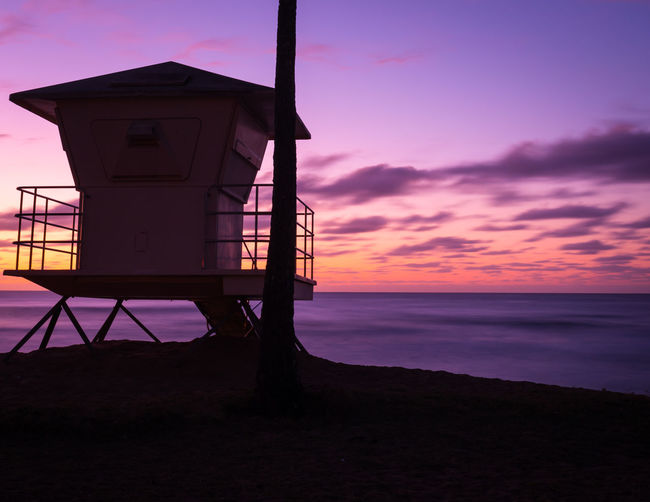 Hawaii Hawaii Life Low Angle View North Shore Oahu Architecture Beach Beauty In Nature Beauty In Nature Built Structure Cloud - Sky Horizon Horizon Over Water Hut Land Life Guard Stand Life Guard Station Lifeguard Hut Man Made Structure Nature No People Outdoors Purple Sky Scenics - Nature Sea Silhouette Sky Sunset Tranquil Scene Water
