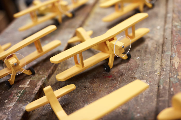 toy planes made in a workshop Aircraft Biplane Boys Toys Craft Flight Model Model Plane Planes Plant Toy Toy Workshoip Transportation Woodwork  Workshop Yellow