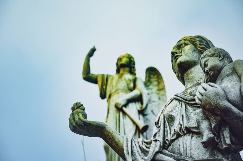 A day in the land of the dead Textures and Surfaces Angel Angel Wings Art And Craft Belief Buenosaires Craft Creativity Day History Human Representation Low Angle View Male Likeness Memorial Monument Nature No People Religion Representation Sculpture Sky Spirituality Statue The Past