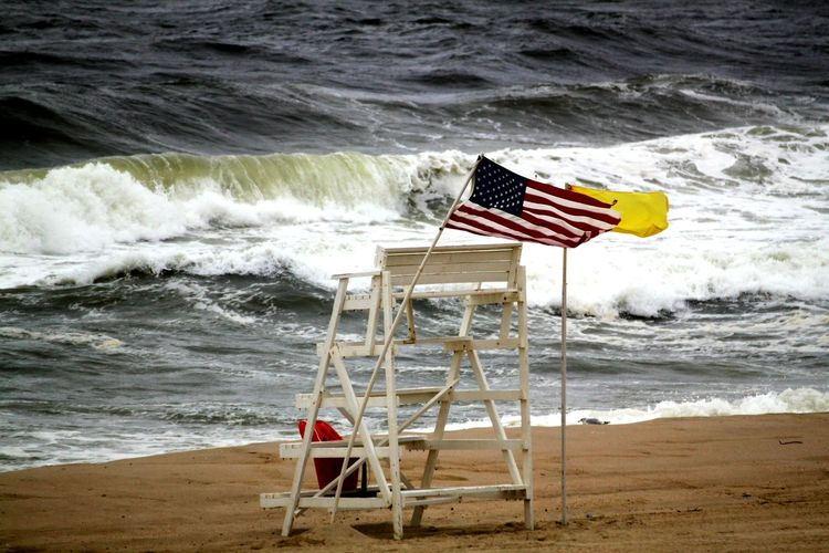 Wind Blowing  Yellow Flag Stormy Weather Popular Photos Street Photography EyeEm Gallery Popular EyeEm Selects Streetphotography No People Check This Out Water Wave Sea Beach Sand Patriotism Flag Motion Cultures Autumn Mood 2018 In One Photograph My Best Photo