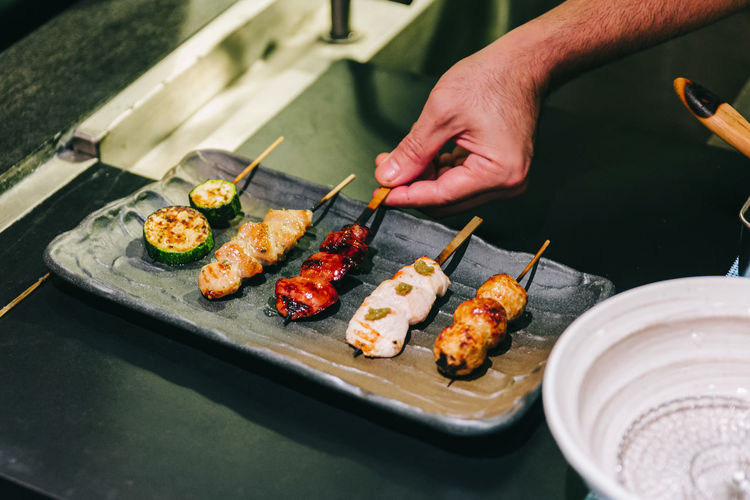 High angle view of sushi on barbecue grill