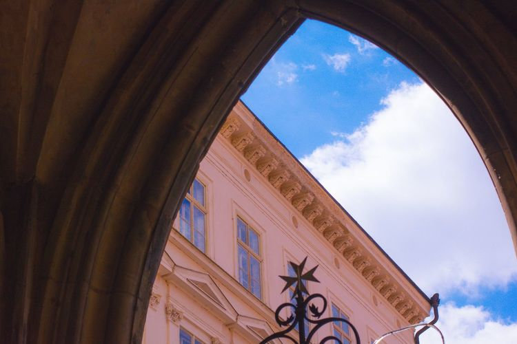 Arch Architectural Feature Architecture Blue Building Built Structure Cloud Cloud - Sky Cloudy Day Design Geometric Shape High Section Historic Low Angle View No People Ornate Sky