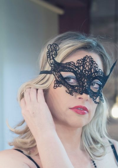 Close-up of woman wearing eye mask at home