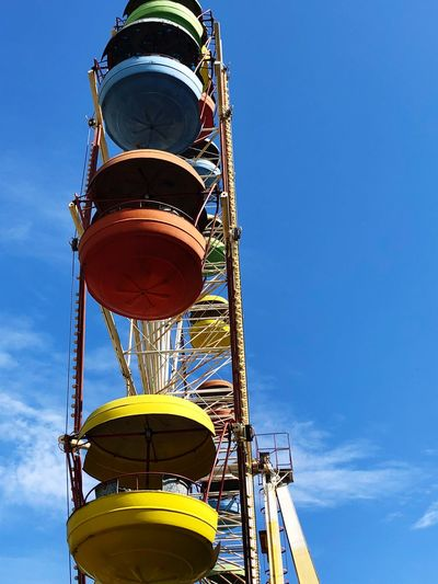 Multicolored ferris wheel Rusty Rollercoaster Amusement Park Ride Low Angle View Sky Blue Metal No People Architecture Nature Creativity Tower Yellow Clear Sky