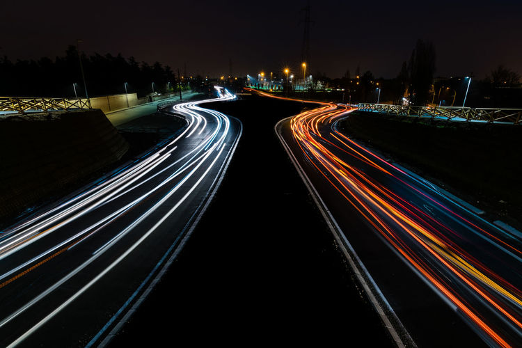 Traffic Cityscape Blurred Motion City City Life Direction Illuminated Light Light Trail Long Exposure Motion Multiple Lane Highway Night No People Outdoors Road Speed Street Tail Light The Way Forward Traffic Transportation Vehicle Light