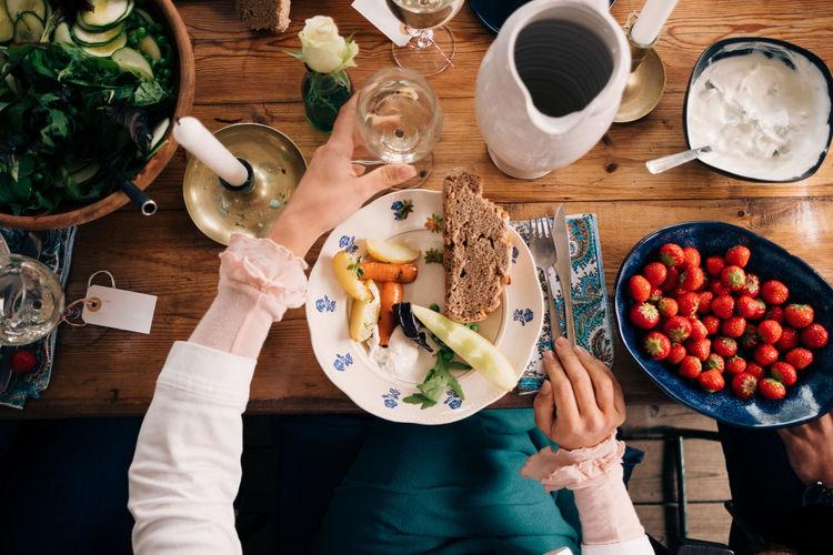 High angle view of woman eating food