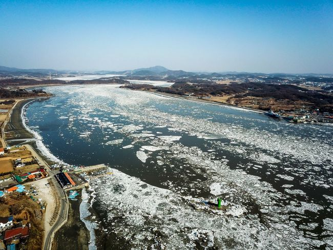 Drift ice of Choji Bridge in Kanghwa island, Korea. Ganghwa Island Korea Winter Choji Bridge Drone Shot Drone Photography Winter WinterSea Sea Ice Island Ganghwa Island Sky Water Nature Scenics - Nature Day Beach Land Sea Tranquility No People Tranquil Scene Beauty In Nature Outdoors Clear Sky Landscape Winter Environment