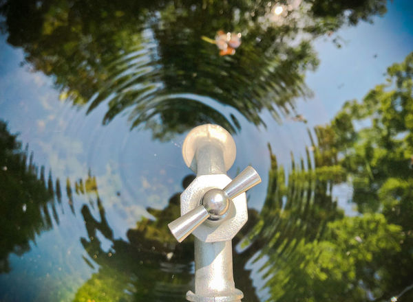 Life Day Drop Focus On Foreground Motion Nature No People Outdoors Reflection Rippled Sunlight Tap Tree Water Well