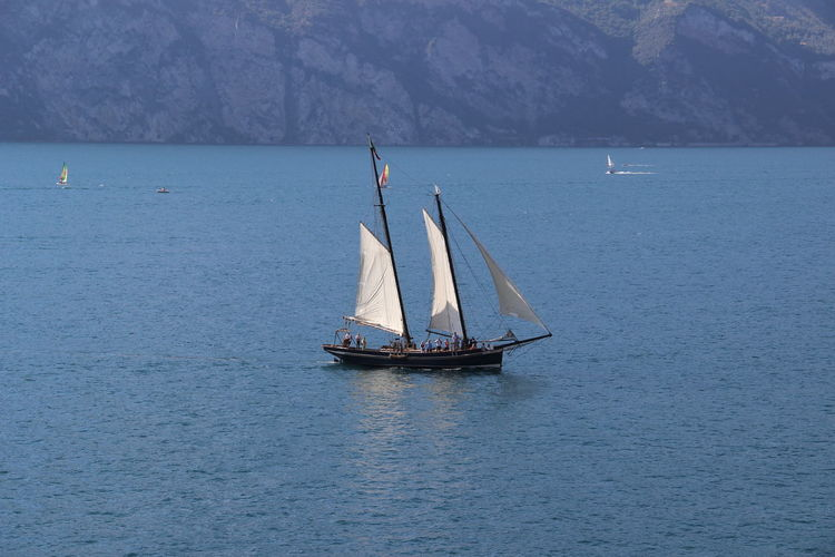 Water Sea Sailboat Nautical Vessel Transportation Mode Of Transportation Waterfront Sailing Scenics - Nature Beauty In Nature Canvas Mountain Nature Non-urban Scene Tranquility Day Tranquil Scene Outdoors Travel No People Yachting Yacht Luxury