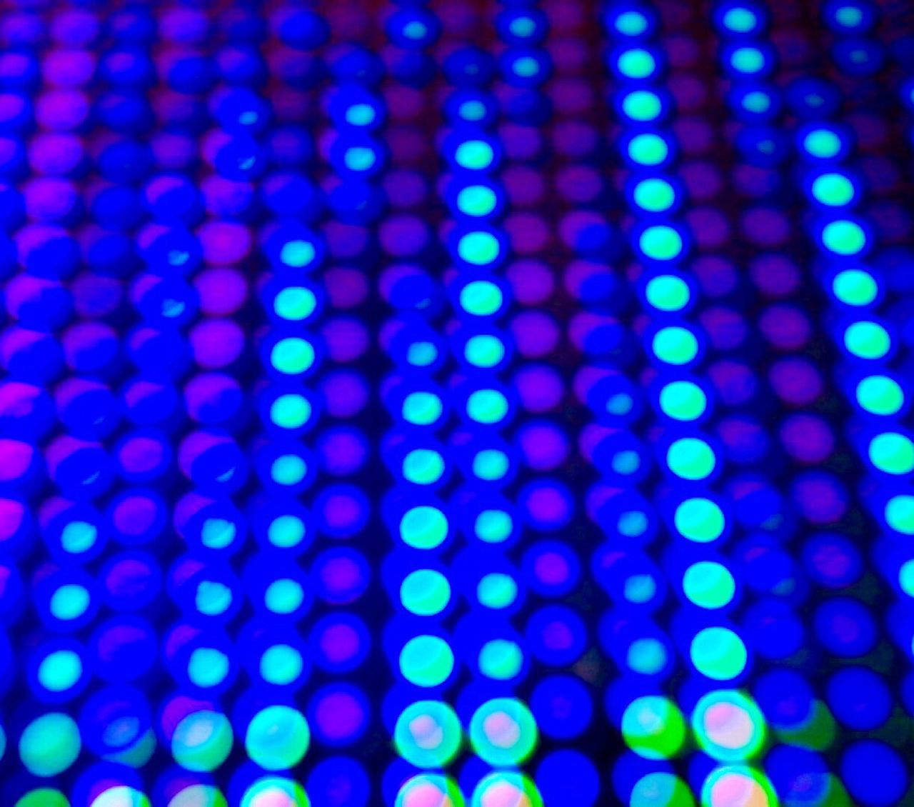 illuminated, pattern, lighting equipment, blue, defocused, abstract, backgrounds, no people, technology, large group of objects, multi colored, industry, futuristic, night, disco lights, neon, close-up