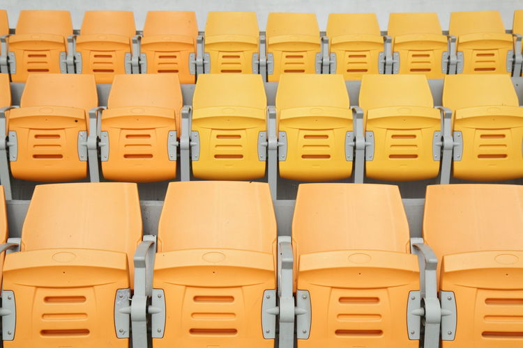 Full frame shot of empty yellow chairs